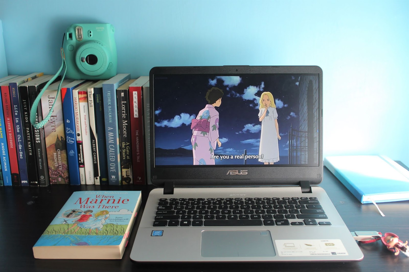 a laptop and a book on the table