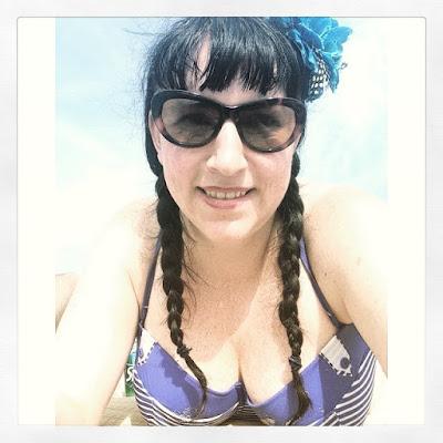 Bridget Eileen Plus Size Pin Up at Hampton Beach in a striped Bikini top from Bare Necessities