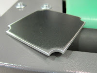 punched metal part edges rounding