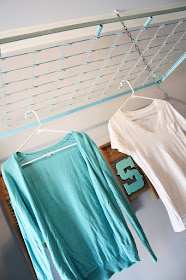 http://adiamondinthestuff.com/2013/10/crib-spring-drying-rack-wash-room-decor.html