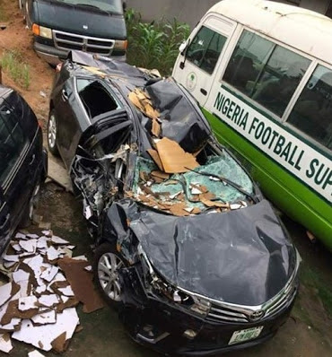 Lucky Man Came Out Of This Accident Alive As Truck Falls On His Car In Lagos