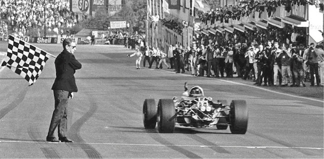 Dan Gurney takes the chequer to win the Belgian Grand Prix at Spa in 1967 in his Eagle-Westlake V12.  Photo Courtesy of All American Racers