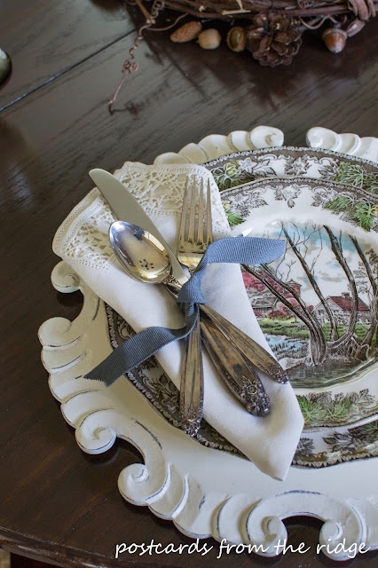 Beautiful Thanksgiving place setting with brown transferware, vintage silverware, and vintage linen napkins.