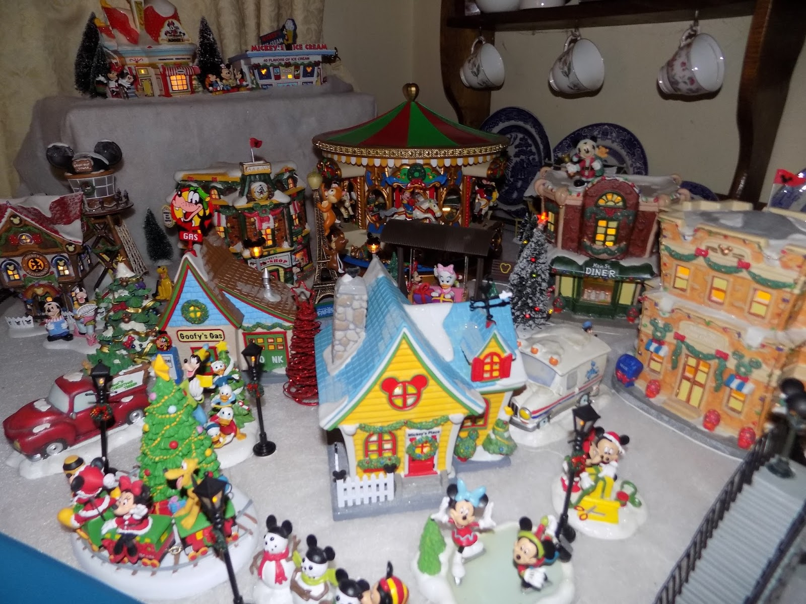 so now we are into december ive got my disney christmas village up and running again yay we all get excited when we get it out in our house