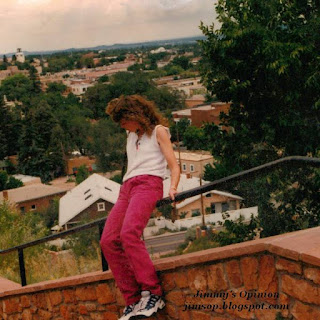 Cindy sliding down a banister in Santa Fe, NM at Cross of the Martyrs