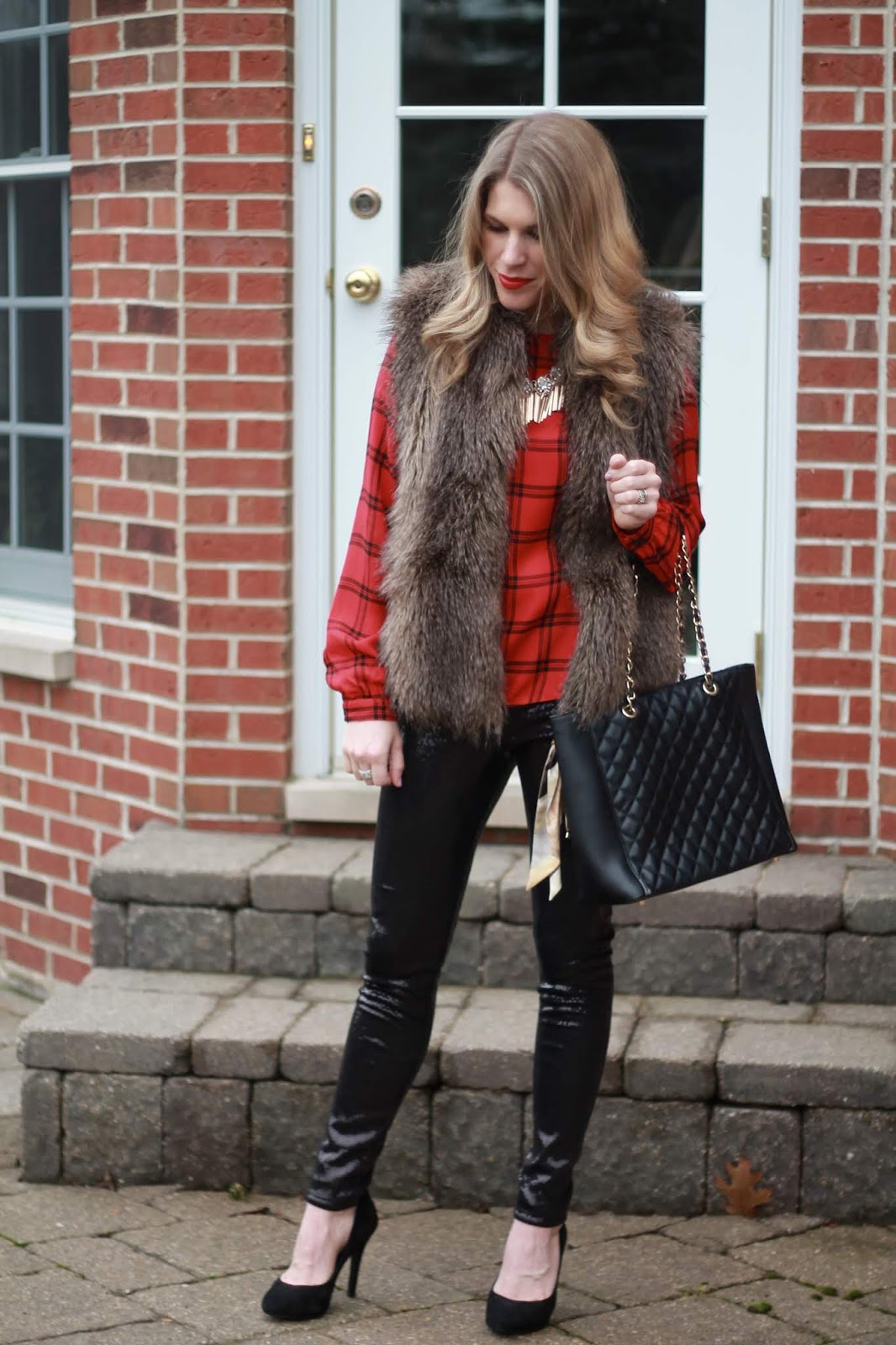 red plaid ruffle blouse, fur vest, sequined leggings, black quilted leather tote, black pumps,