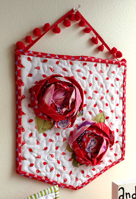 Dimensional roses on fabric banner