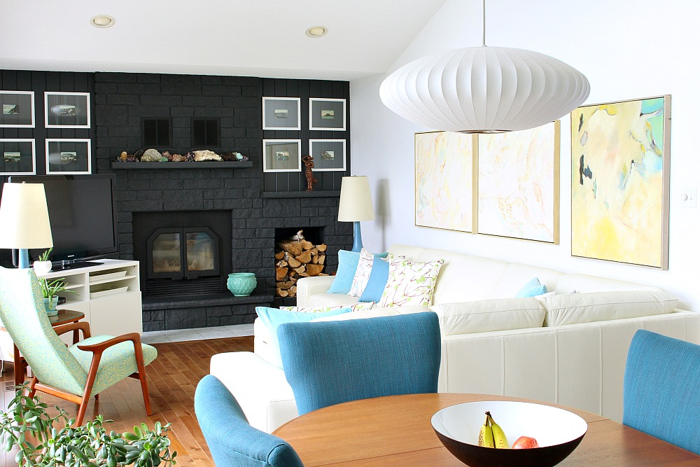 Lakehouse Living Room: Cream Leather Sofa, Black Fireplace, MCM Accents
