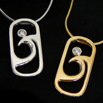 silver and gold pendants, each with a diamond