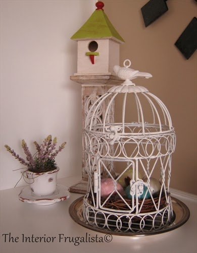 Birdhouse on a wooden candlestick for our Spring Mantle under $10.00!