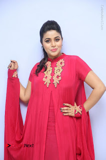 Actress Poorna Latest Stills in Red Dress at Rakshasi First Look Launch  0077.JPG