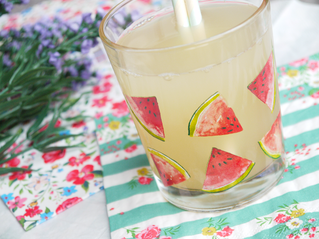 apple juice in a glass with a watermelon print design