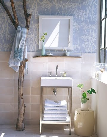 standing driftwood branch in bathroom