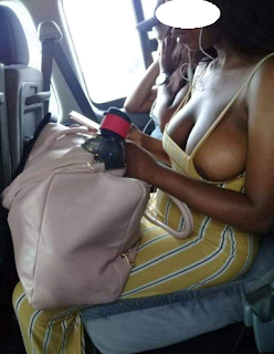 Woman's breast spills out of her dress in a public bus in Lagos and man takes her photo and shares online