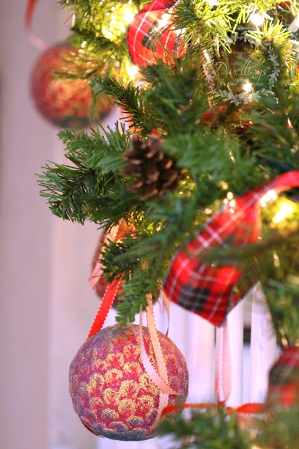 Plaid Christmas ribbon and ornaments on the banister