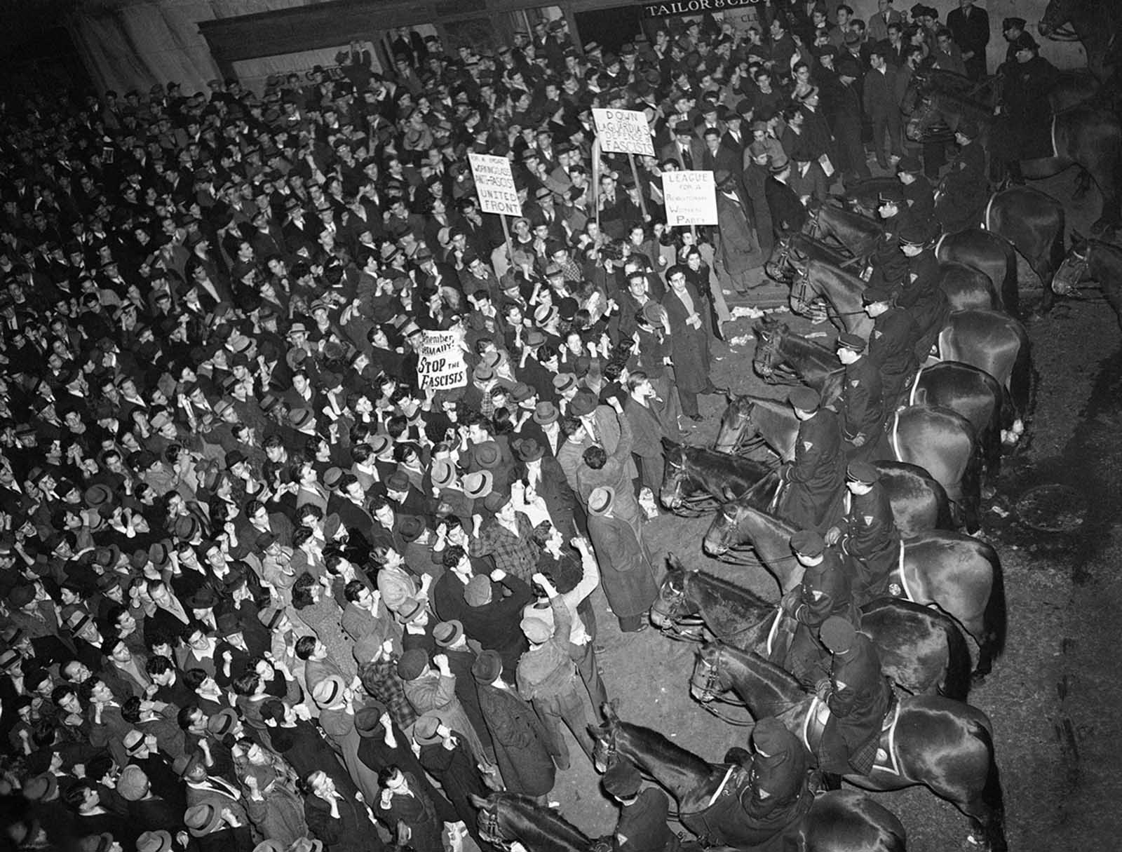 New York City's mounted police form a solid line outside Madison Square Garden on February 20, 1939, to hold in check a crowd which packed the streets around the Garden where the German American Bund was holding a rally. To prevent any clash between bundsmen and counter-demonstrators, police surrounded the area with a force of 1,500.