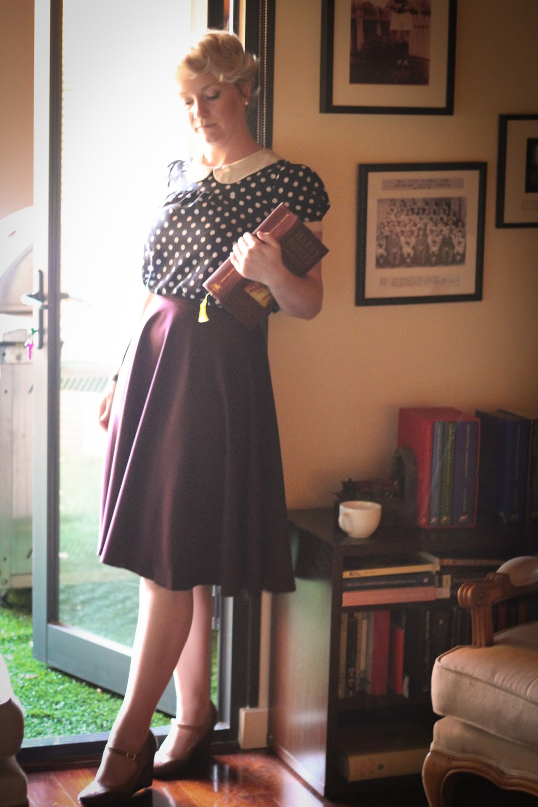 Liana of Finding Femme wears plum Modcloth midi skirt, wedge heel oxfords, and Modcloth navy polka dot peter pan collar blouse.