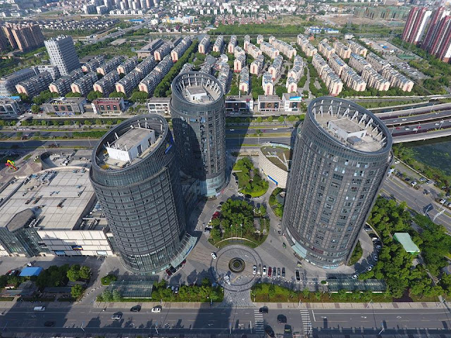 Chinese architecture fans toast 'beer keg' tower blocks in Suzhou