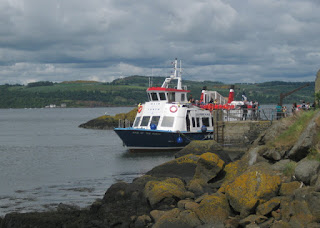 Maid of the Forth boat docked at Inchcolm, Scotland