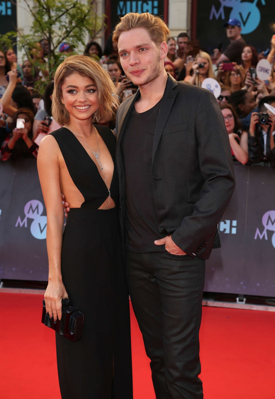Hyland and Dominic Sherwood walk the red carpet