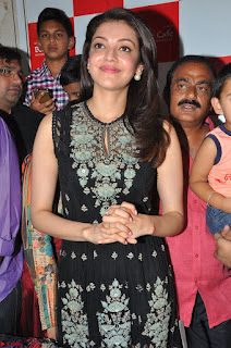 Kajal Aggarwal in lovely Black Sleeveless Anarlaki Dress in Hyderabad at Launch of Bahar Cafe at Madinaguda 006.JPG