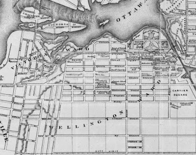 Crop of 1874 map of Ottawa with extents Sussex Street (East), City Limit (Gladstone, South), Rochester/Broad Street (West) and the north edge of Ottawa River (North). Victoria Ward and Wellington Ward are both noted in large print. The city limit runs along what is now Gladstone Avenue in a straight line as far west as Division (Booth) despite the road not continuing west of Concession Line (Bronson), then continues north along Division to Richmond Road (Albert), then goes west out of view. Various prominent buildings (churches, schools, Parliament buildings) are outlined and labelled. Geographic features (islands, hills) are also drawn. Wellington Street runs along the south border of Parliament Hill, between the Rideau Canal and the gorge just east of LeBreton Flats. A hashed line, indicating the streetcar route, begins at the north end of Bridge Street (at the south shore of the Ottawa River), down Bridge, turning southeast at Duke, east at Queen Street, northeast at George Street (Wellington), east on Wellington, south on Bank for one block, east on Sparks Street to and across the Sapper's Bridge over the Rideau Canal, then up Sussex Street off the map.