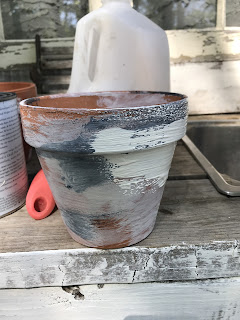 Adding texture to make a new clay pot look like a vintage one.