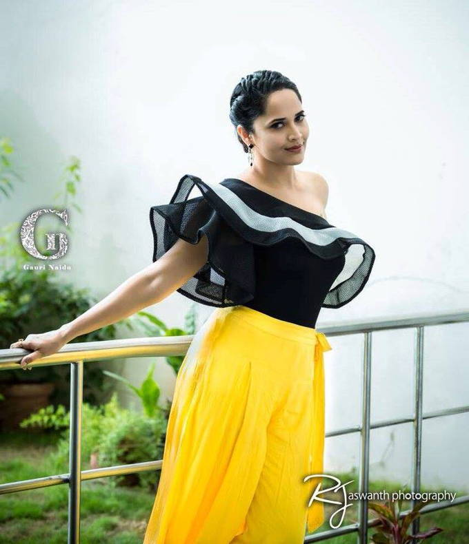 Telugu Tv Anchor Anasuya Photos In Black Top Yellow Lehenga