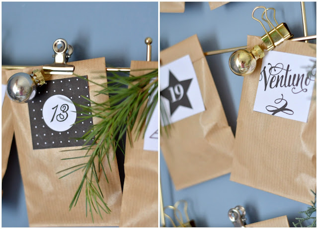 Calendario dell'Avvento fai da te con sacchetti di carta kraft, clip in metallo dorato e rametti di pino