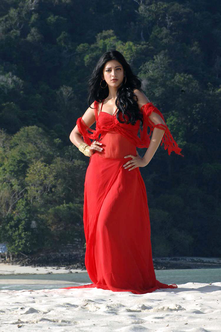 suave and glamorous Shruthi hot pics at beach in red and orange