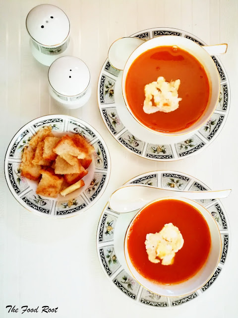 Creamy tomato soup filled with just 3 basic ingredients - garlic, carrots, and lots of home picked tomatoes. It's low in calories and makes a great afternoon snack too.
