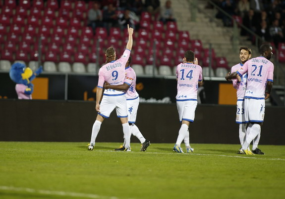 Evian player Kévin Bérigaud celebrates with his teammates after scoring a goal against Rennes