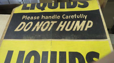 Old printed sign reading CHEMICALS Do Not Hump