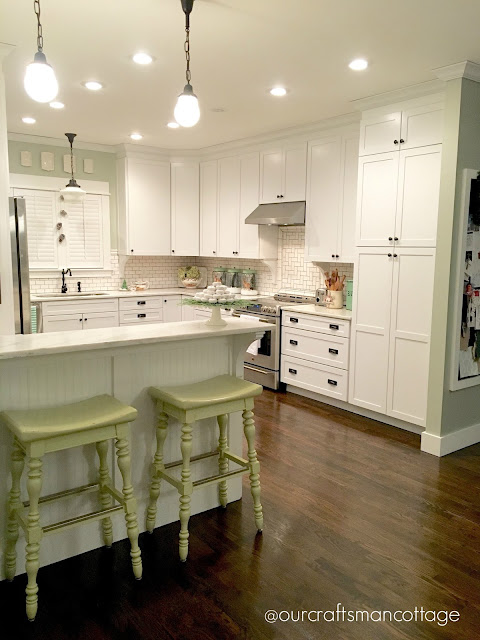 Craftsman style, Craftsman cottage, cottage kitchen, Shaker style cabinets, Rejuvenation lighting, white kitchen, light bright kitchen, wood floors in the kitchen, subway tile backsplash, home tour, featured home