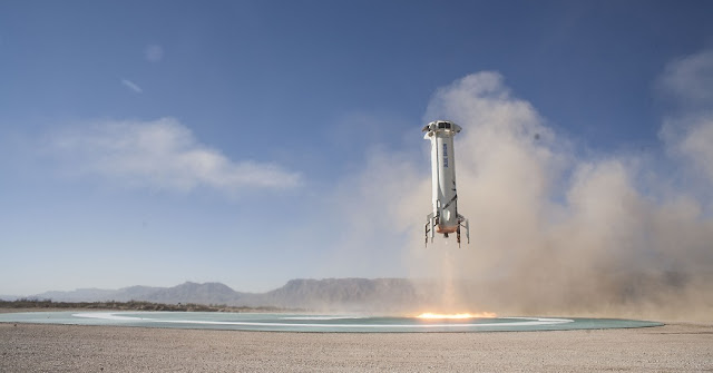 New Shepard Booster landing on the pad in West Texas after a successful Mission 7. Credit: Blue Origin