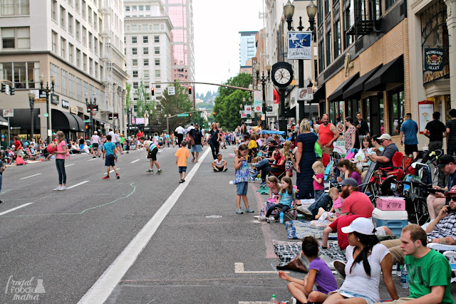 City-goers line up on the streets for the Starlight Parade that features an impressive line-up of illuminated floats as the sun goes down over the city streets during the Portland Rose Festival each year.