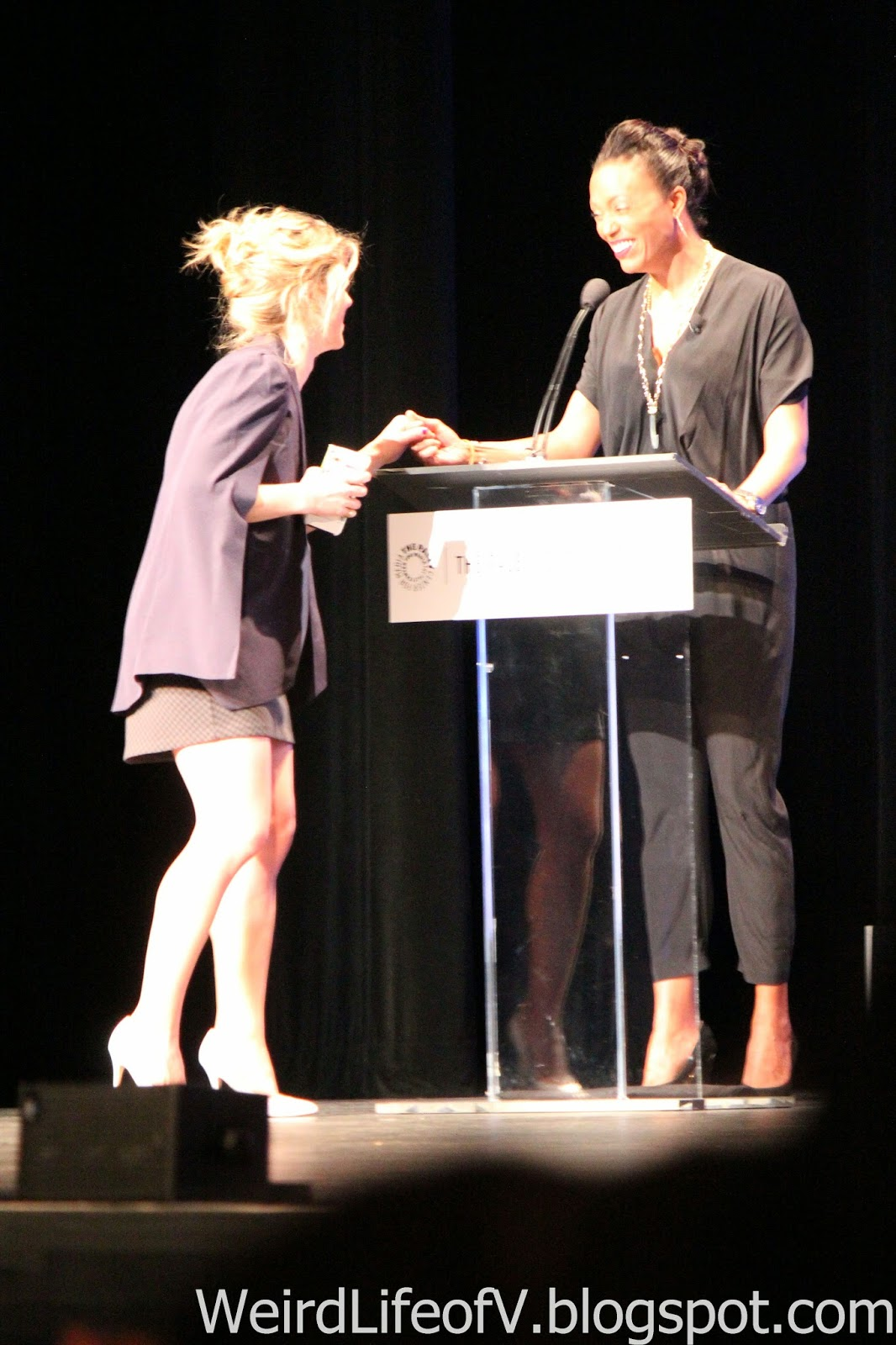 Emily Bett Rickards stops by the moderator's podium to talk to Aisha Tyler