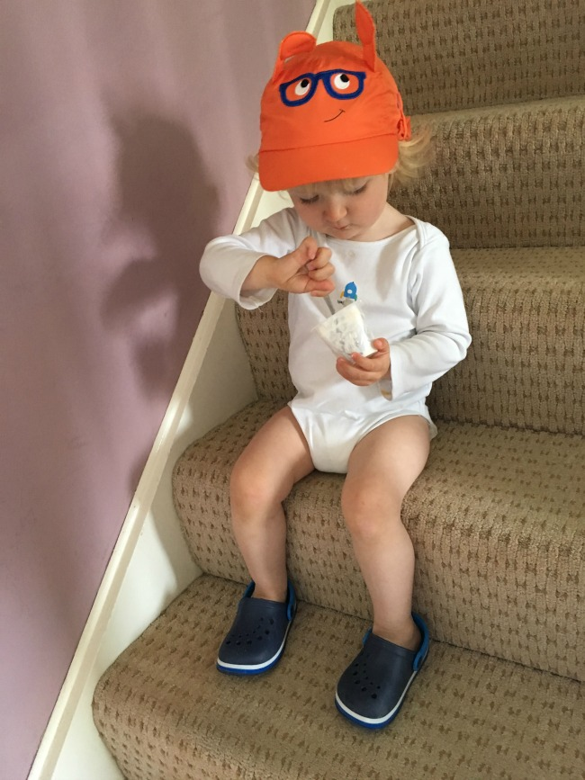 Bear-Moves-Home-toddler-sat-on-stairs-eating-yoghurt