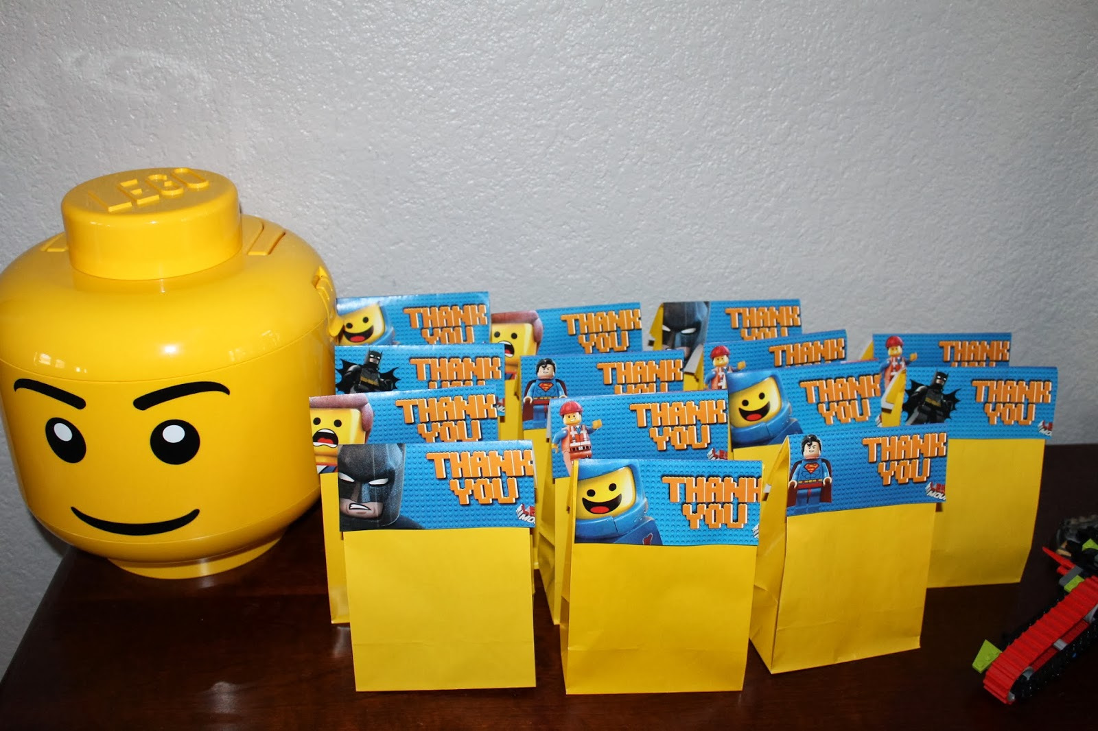 And The Contents Of Goody Bags A Lego Movie Mystery Minifigure Pencil Eraser Some Stickers Candy Bar In