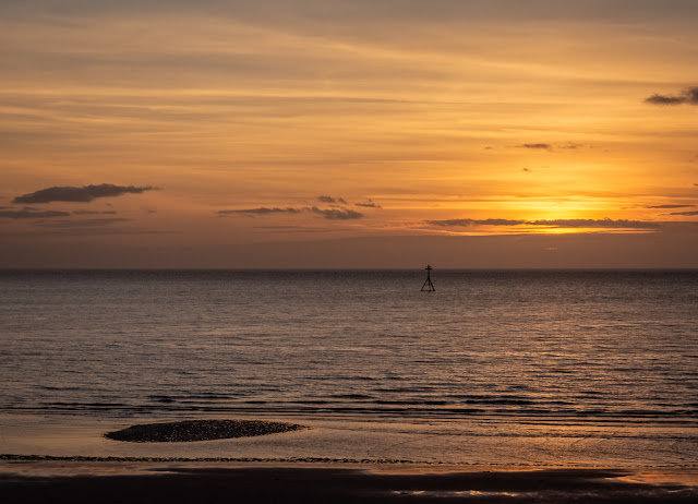 Photo of the sun going down over the Solway Firth