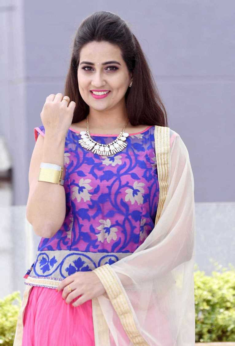 TV Anchor Manjusha Latest Stills In Violet Dress