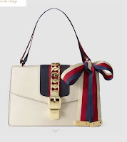 http://www.wholesale7.net/wholesale-fashion-metal-velcro-stripe-shoulder-bag_p219172.html