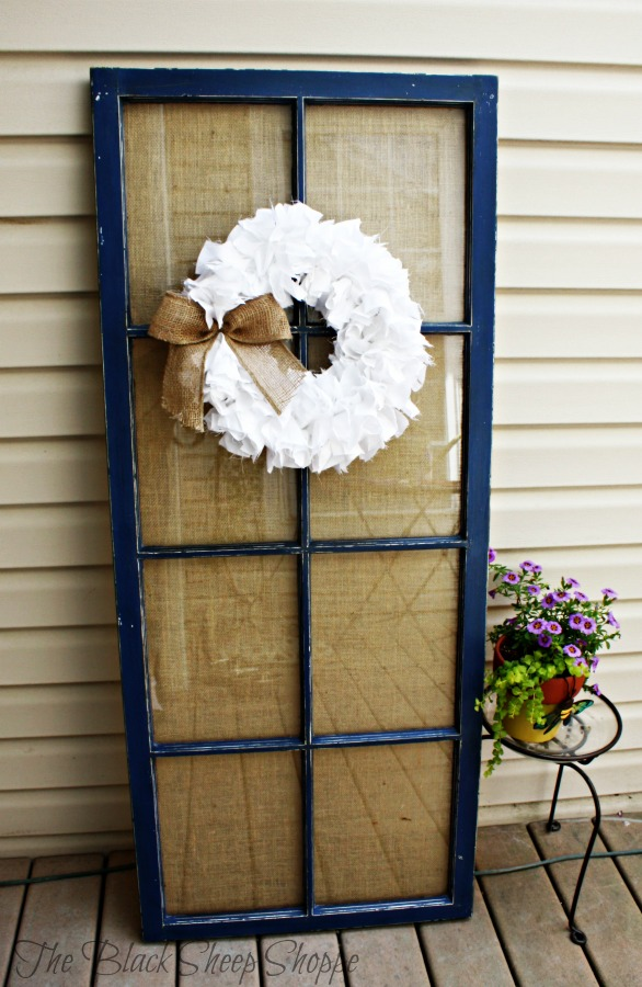 Use an old door as a backdrop for a wreath or artwork.