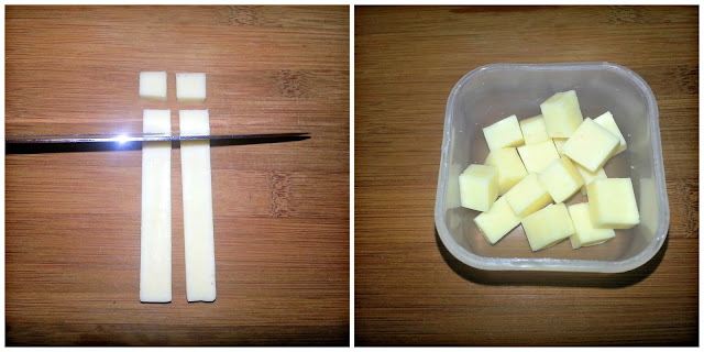 Knife slicing cheese strips and cubes of cheese