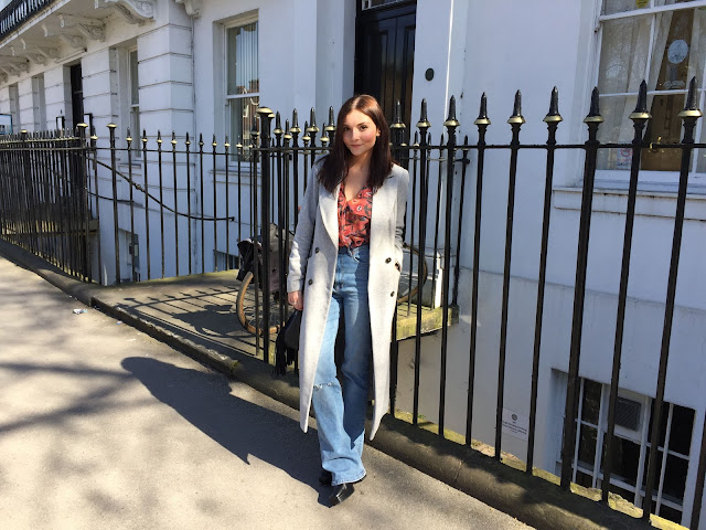 uk blogger wearing blue flared jeans