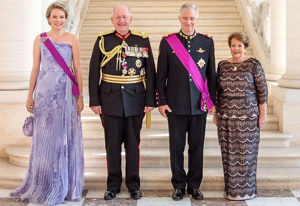 Queen Mathilde wore Natan Couture floral dress, Maison Natan dress, and Aramani blue one shoulder silk dress. Queen Fabiola's Wolfers tiara
