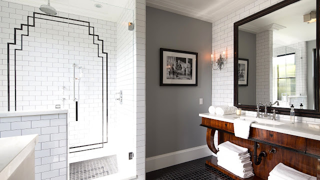 Guest bathroom grey walls floor to ceiling white subway tiles black art deco motif in shower wood cabinets
