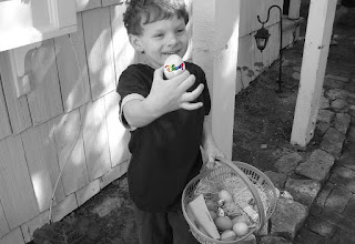 Child holding Disney egg from basket