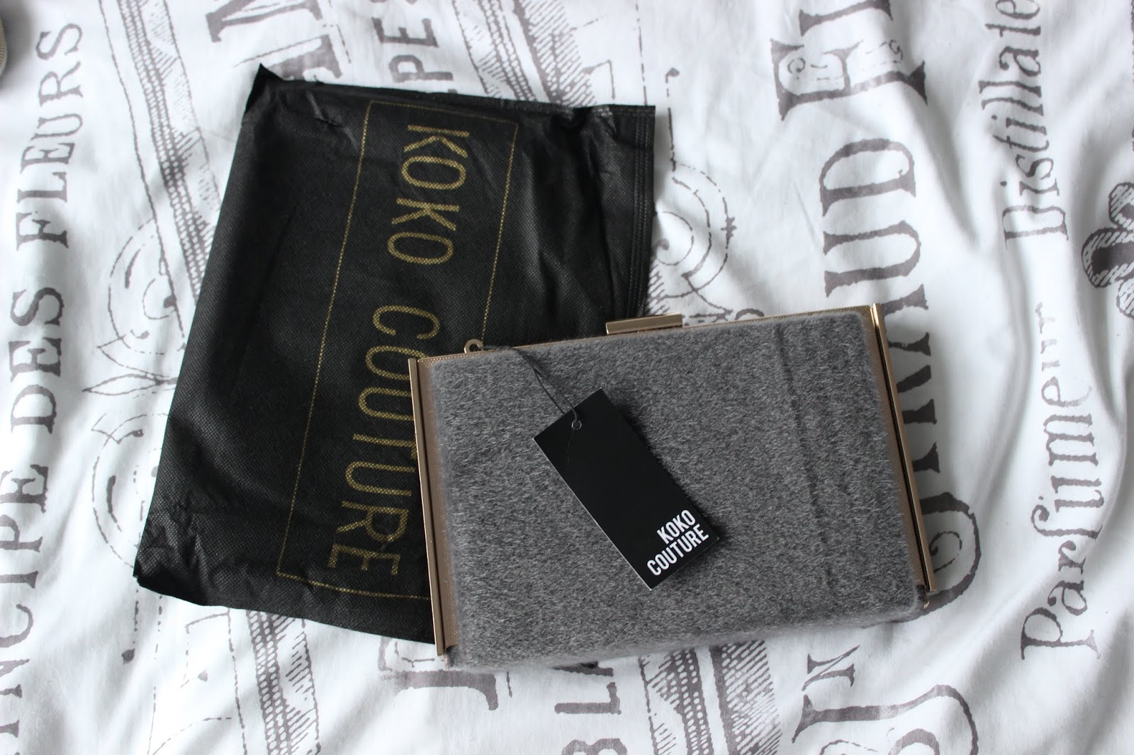 A grey fur KoKo Couture clutch bag