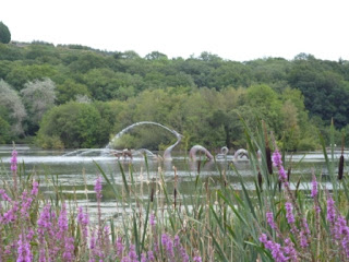Welsh Dragon in the lake at Llandrindod Wells, Wales
